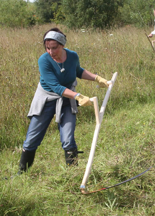 young woman scything